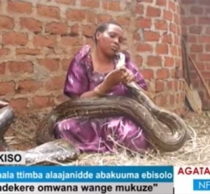 Video+ Photos: Please Don't Take My Child: Woman Who Gave Birth To Python Pleads To Wildlife Officials
